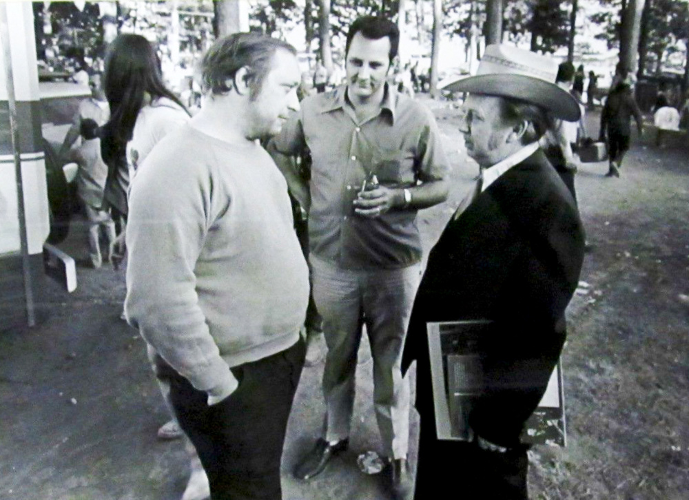 From the Archives:  Dick Freeland, John Duffey and Carlton Haney in Culpeper, Virginia, June 10, 1972. The three men were at Jim Clark's Culpeper Blue Grass Folk Music Festival.  When this photograph was taken, Freeland was the head of Rebel Records, Duffey was a member of the Seldom Scene (which recorded for Rebel), and Haney was a promoter of musical events (including on at Culpeper), visiting another promoter's festival on a busman's holiday.   Photo by Carl Fleischhauer.