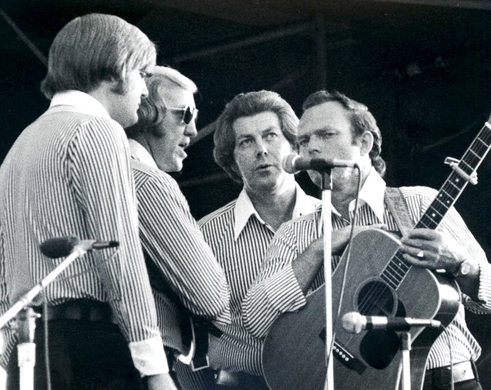 From the Archives:  Ricky Skaggs, Doyle Lawson, Bill Yates and Charlie Waller.   Photo by Ron Petronko.