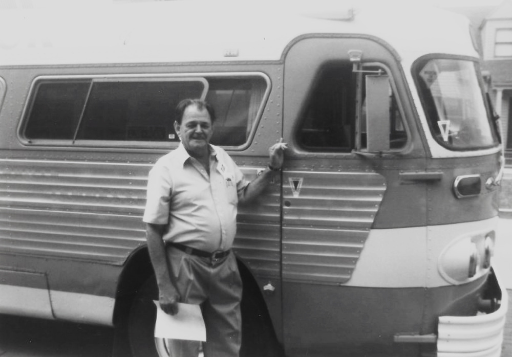 From the Archives:  Lance LeRoy, standing next to the Martha White Bus.  Source unknown.