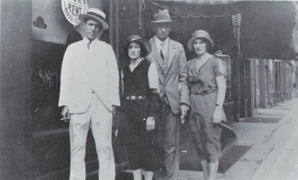 From the Archives:  Jimmy Rodgers and the Carter family on downtown sidewalk.  L to R:  Jimmy Rodgers, Mabelle Carter, A.P. Carter, Sara Carter.   Donated by Roger Sprung.