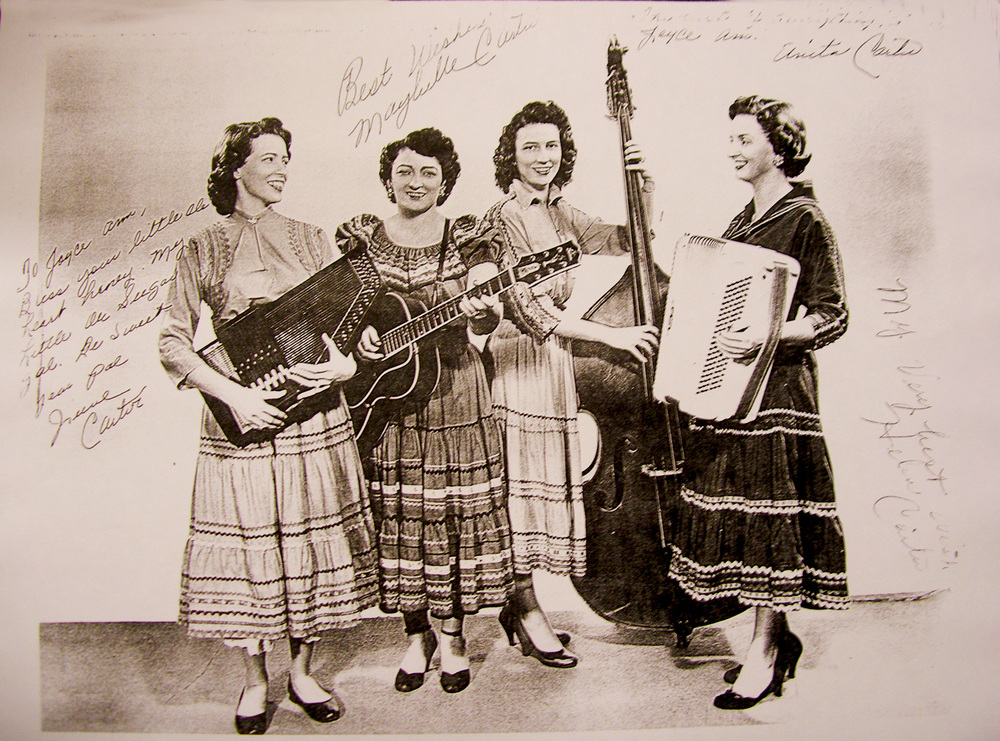From the Archives:  Maybelle Carter and girls, June, Joyce, Helen with their instruments.  This copy is autographed by all of the individuals in the photograph.   Donated by Bill Morrison.