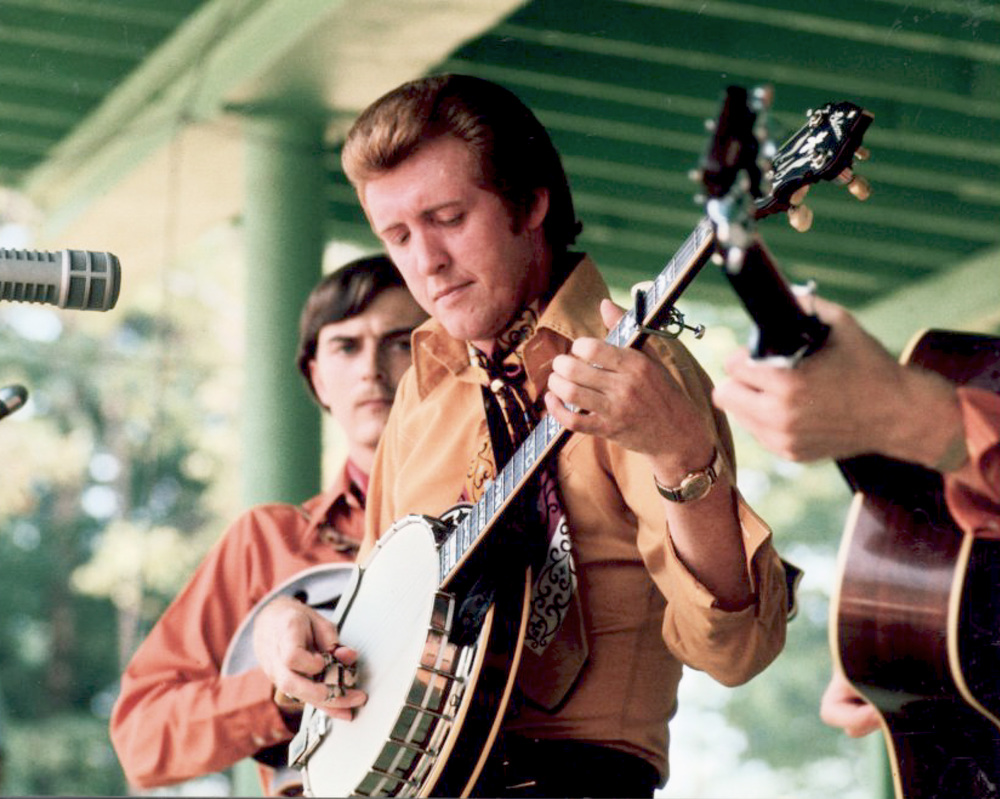 From the Archives:  Larry Rice, J.D Crowe and Doyle Lawson (hidden on guitar) at the Reidsville Festival 1970, Labor Day Weekend, Camp Springs, North Carolina.   Photo by Ron Petronko.