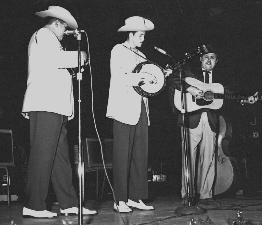 From the Archives:  Paul Williams, J.D. Crowe and Jimmy Martin in 1958 at the WWVA Package Show in Ottawa Auditorium at Lansdowne Park in Ottawa Ontario, Canada.   Photo by Ron Petronko.
