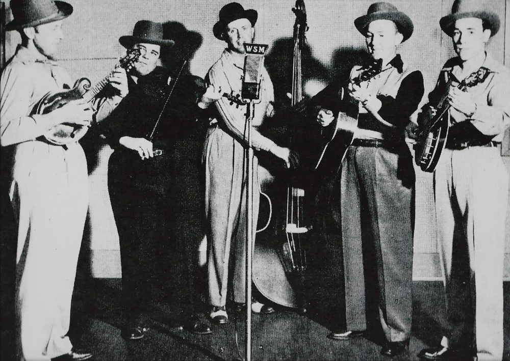 "From the Archives:  Bill Monroe and the Blue Grass Boys '""classic"" lineup. L-R: - Bill Monroe, Chubby Wise, Howard ""Cedric Rainwater"" Watts; Lester Flatt; Earl Scruggs, circa mid 1940's.  Source Bluegrass Unlimited."