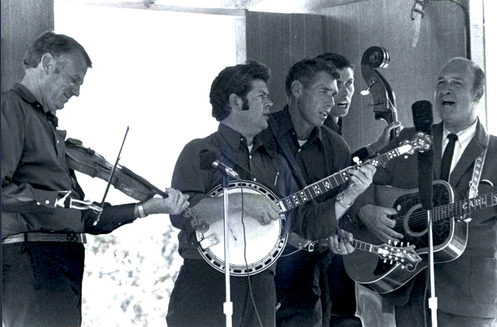 From the Archives:  Carl Story with the Rambling Mountaineers (L-R) Frank Hamilton, C.E Ward, Lee Jones, Bruce Jones and Carl Story at Garland, Texas 1971.   Photo by Ron Petronko.