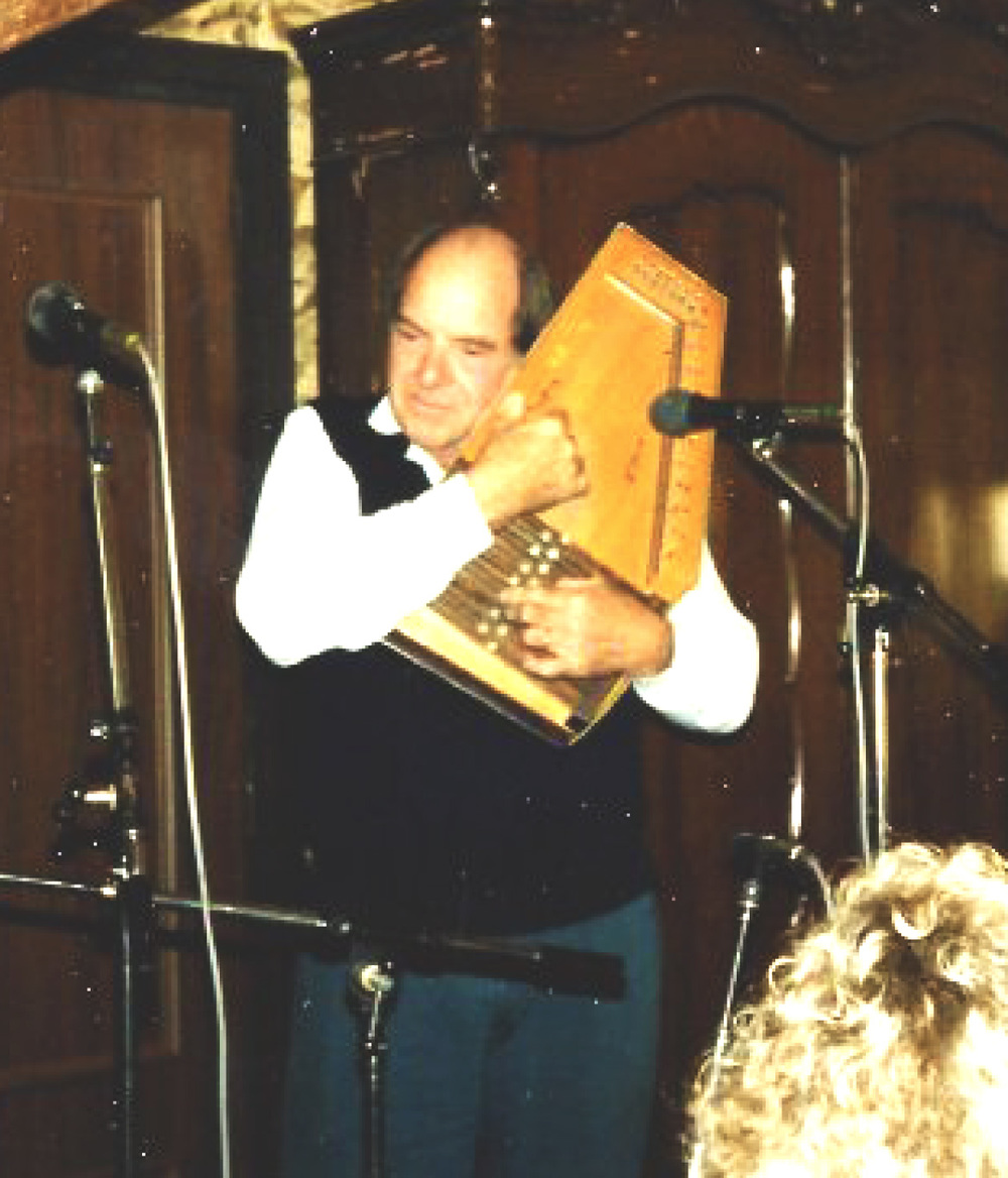 From the Archives:  Bill Clifton playing an autoharp in 1990.  Donated by Strictly Country Records.