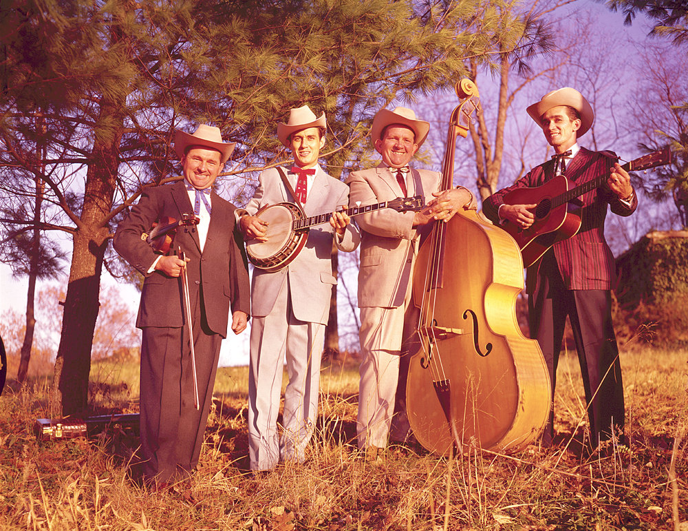 From the Archives:  The Lonesome Pine Fiddlers, early 1960s.  Left to right:  Curly Ray Cline, Ray Goins, Ezra Cline, Melvin Goins.   Photo provided by Gusto Records, Inc.