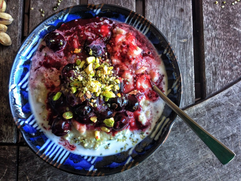 Toasted coconut oats with stewed cherries + crushed pistachios