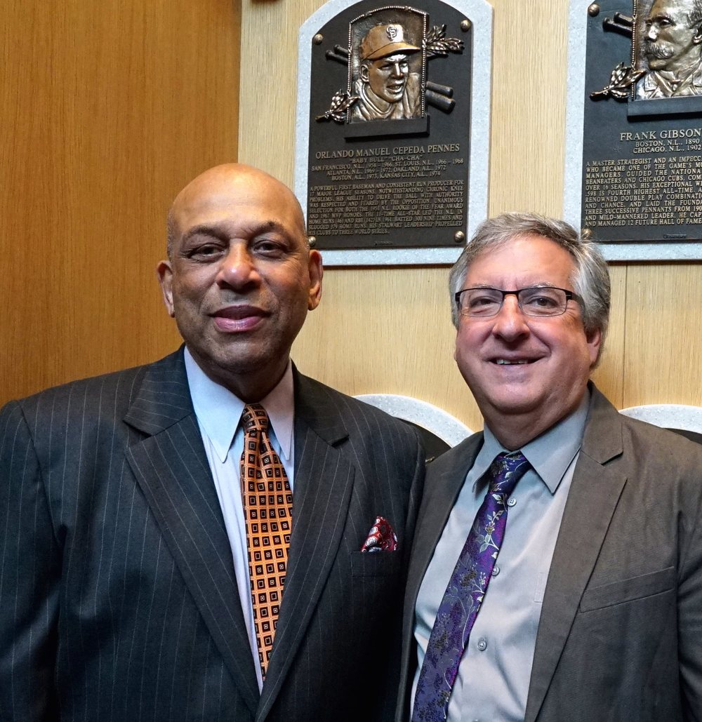 Hall of Famer Orlando Cepeda and AArora ShowCase founder and managing partner Alan Arora visit Orlando's plaque in the Hall of Fame's Grand Hall.