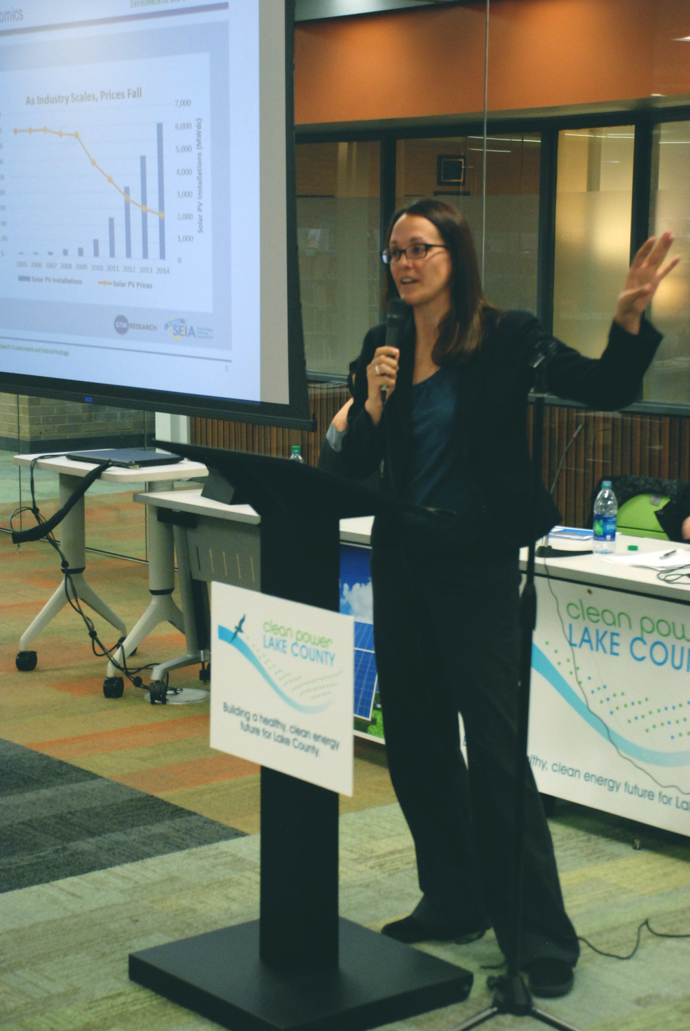 Sarah Wochos informing about transitioning to clean energy