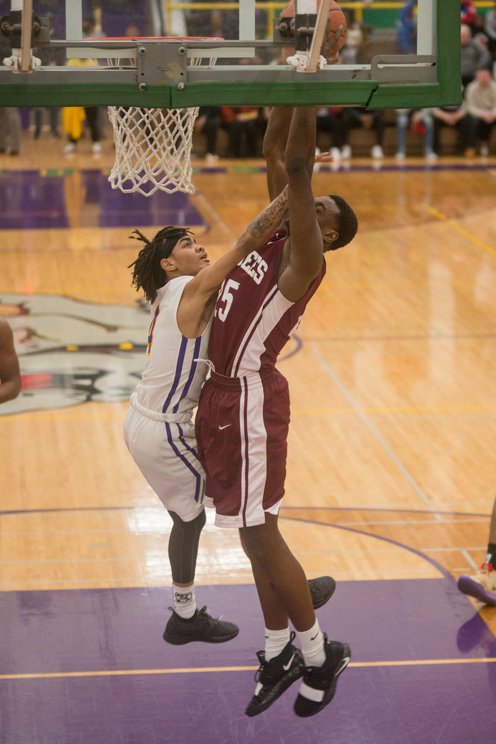 32-Andre-White-Jr-goes-up-for-a-block-vs-Zion-Benton.jpg
