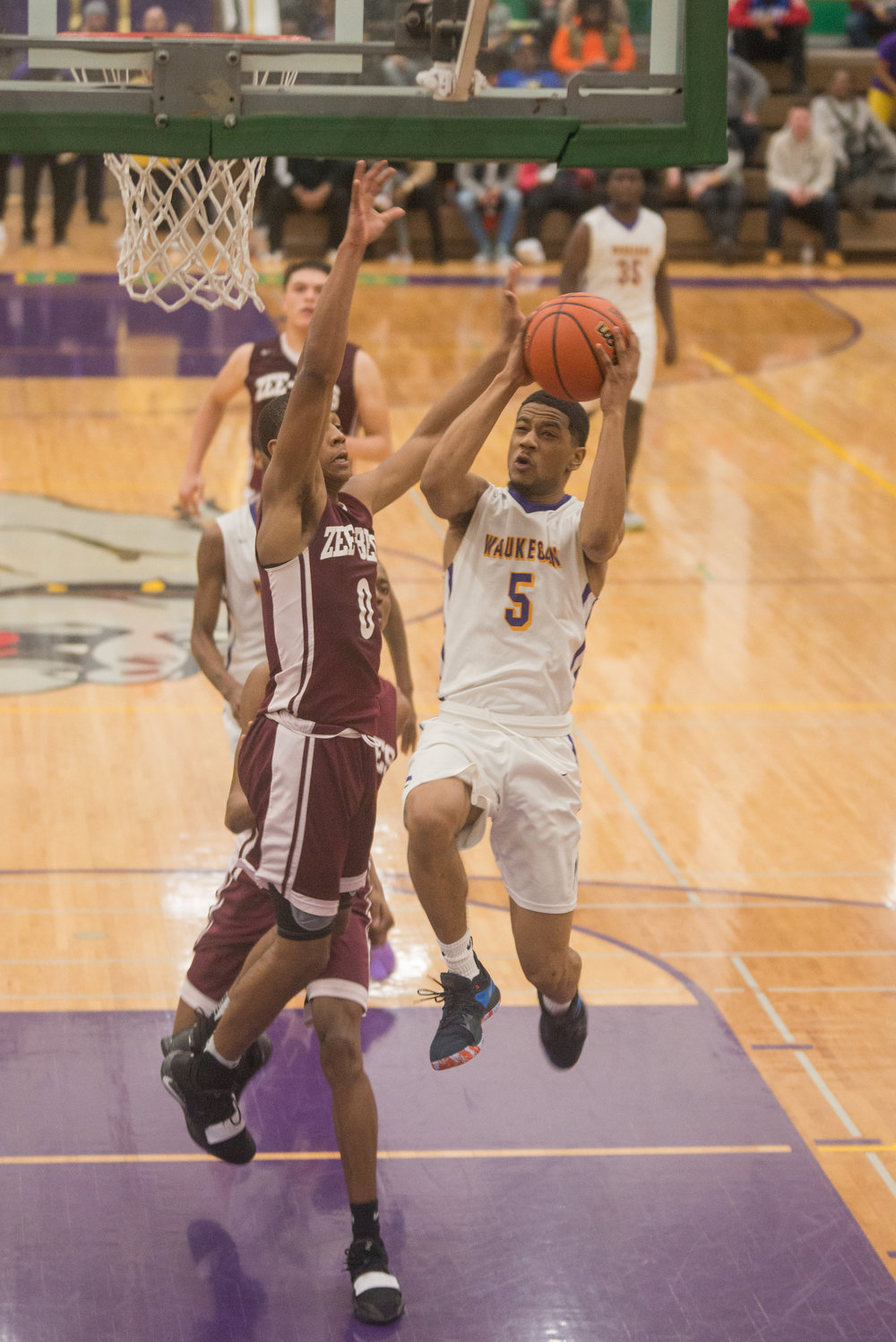 35-Jordan-Brown-goes-up-for-layup-vs-Zion-Benton.jpg