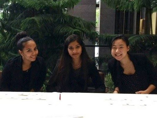 "Marcella (YB-NY '16), Mahin (YB-NY '15), and Karen working the sign-in table at the launch of ""America By the Numbers."""