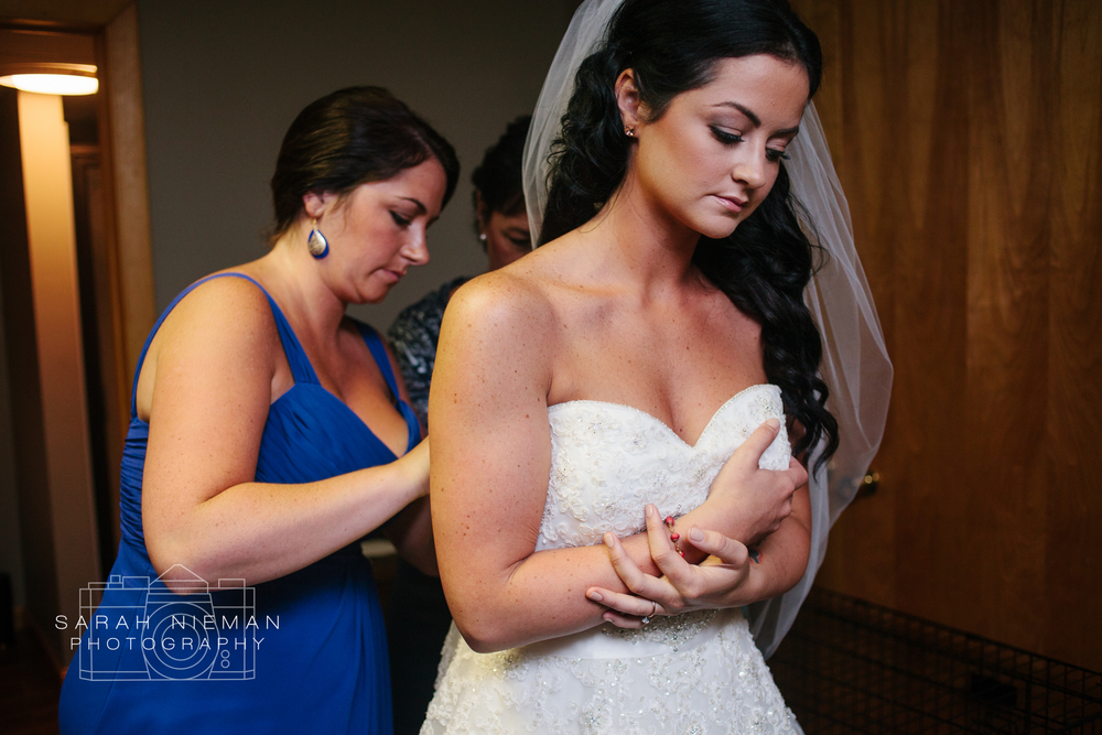 I don't think I've ever seen a bride look so gorgeous while putting her dress on.