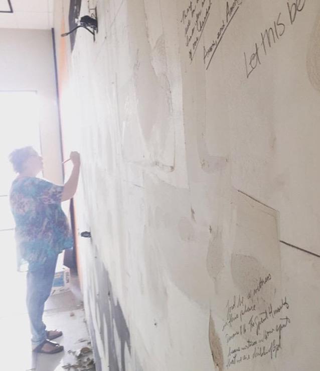 Mama writes verses on walls