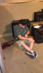 Derek stringing up da bass so he can slappa da bass mon!