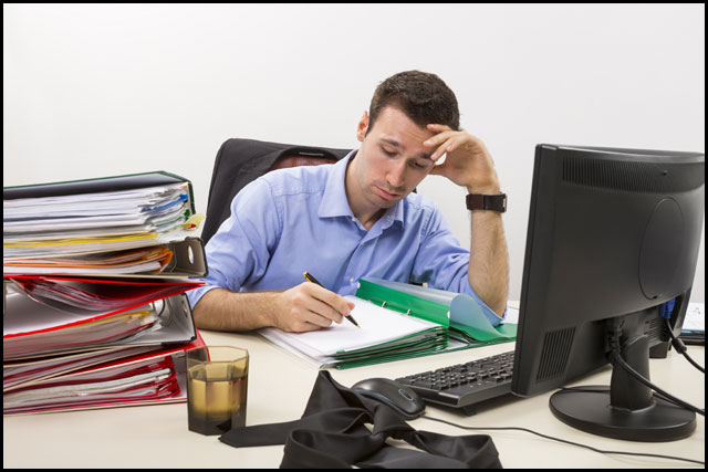 whitemanagement-overworked-businessman.jpg