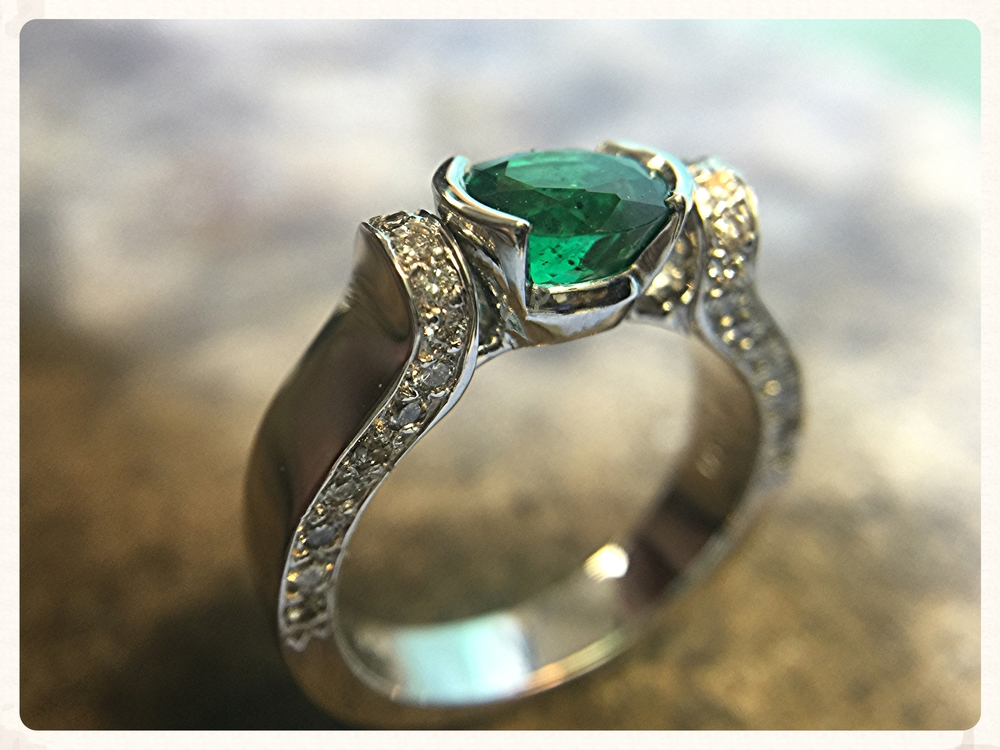 18K white gold ring with 1.20ct oval emerald. Available from Grimball Jewelers.