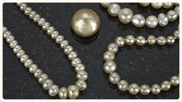 Several natural pearl strands and a large single pearl from the Arabian Gulf.  From the Gemological Institute of America.