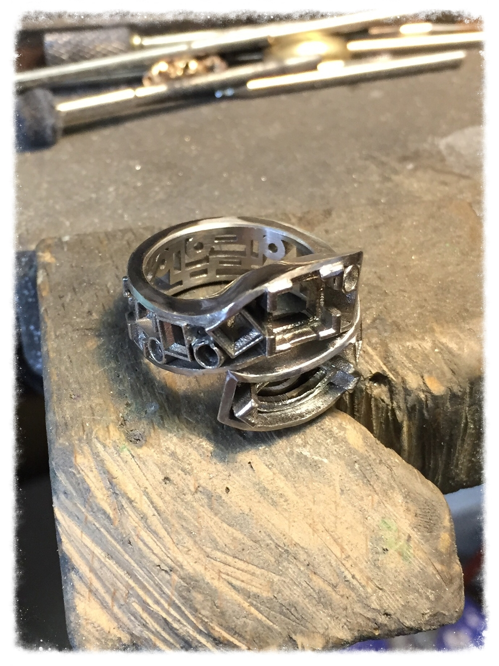 After the client approved the CAD version, her ring was printed in resin with a 3d printer and then cast using the traditional lost wax method.  In the lost wax method the resin model is encased in plaster and then placed in a special oven to burn out the resin -- leaving an exact negative of the ring.