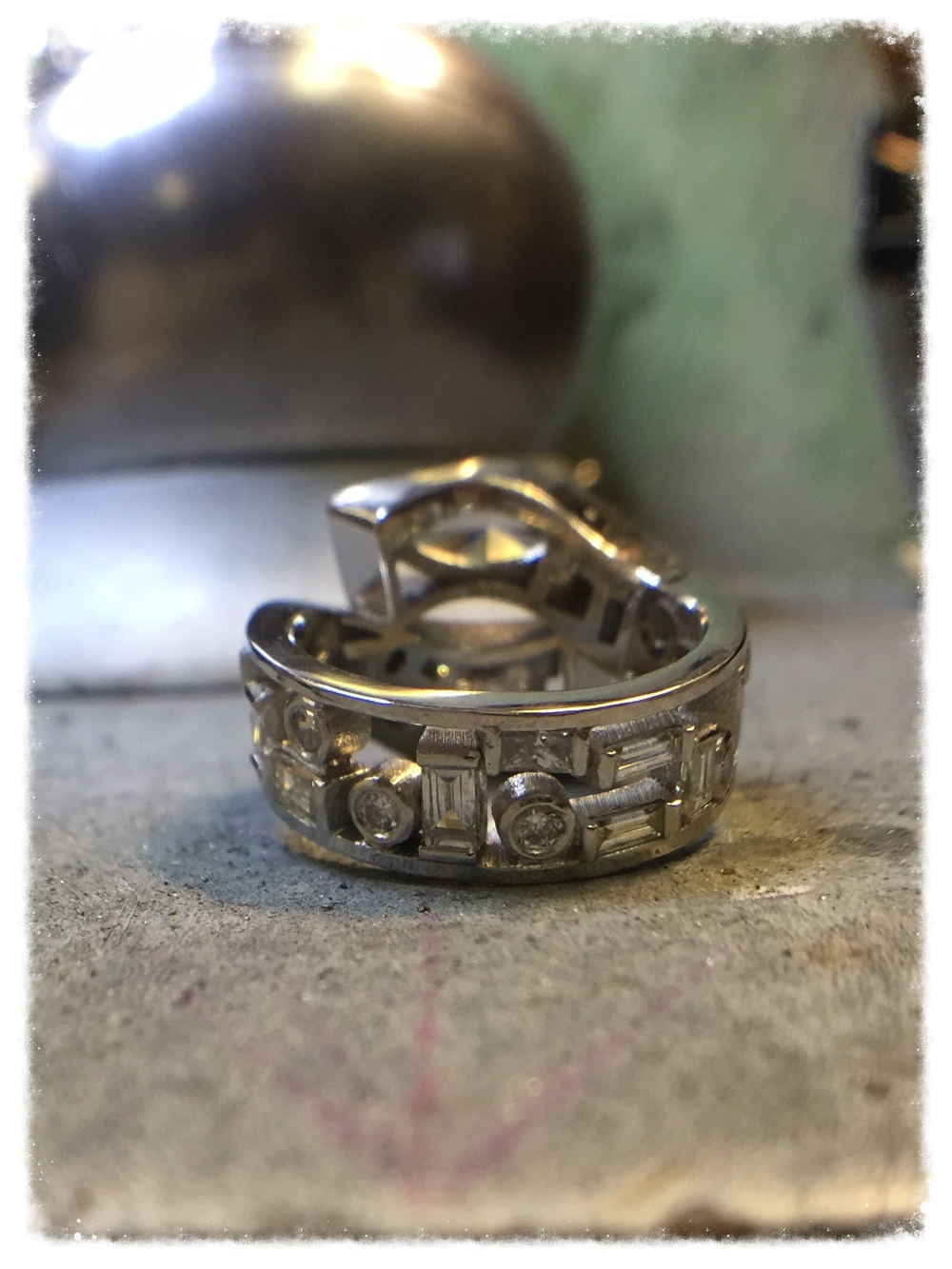 The stones have been set and now the ring is ready for finishing.