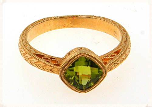 This 14K yellow gold filigree ring holds a 1.18ct natural peridot.