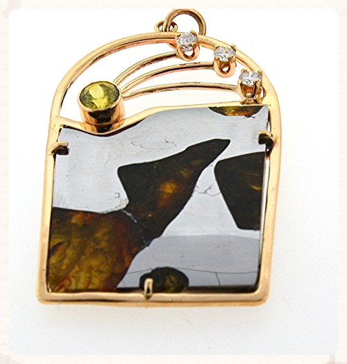 This pendant made by Berkeley Grimball features a slice of pallasite.  Notice the peridot crystals.