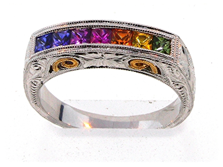 This hand-carved ring shows the rainbow of variety available in sapphire colors.