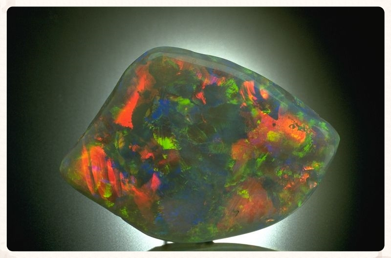 The Dark Jubilee Opal is a 318.4-carat free-form polished black opal from a mine in Coober Pedy, Australia. From the Smithsonian Institution.