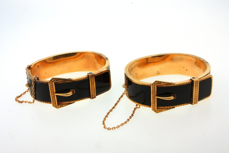 In Victorian times, bangle bracelets were worn as matching pairs; it is rare today to find a complete set. These mourning bracelets are gold and black enamel.