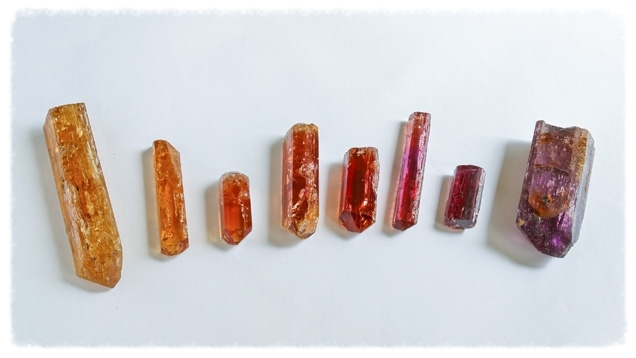 Topaz crystals are typically elongated, with grooves parallel to their lengths. For this reason, they're commonly cut into long oval or pear shapes. From the Gemological Institute of America.