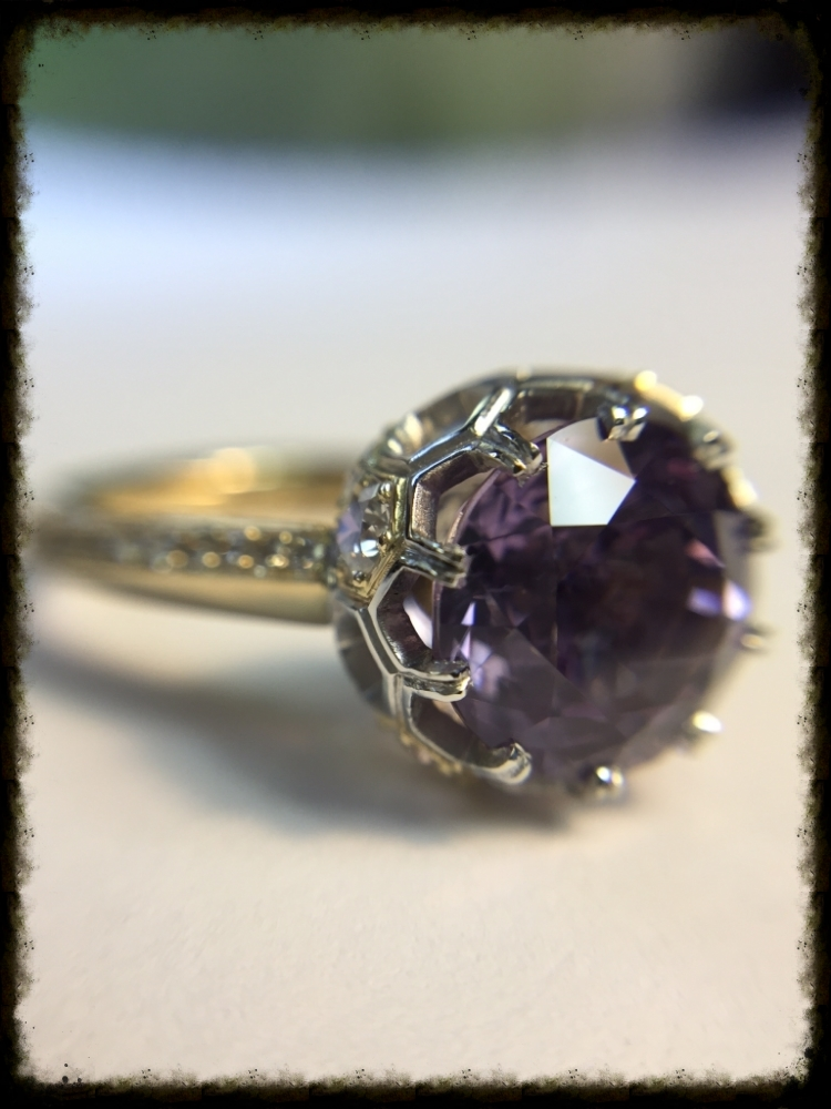 This picture of the final ring show the spinel close up and the prongs... 10 in all.