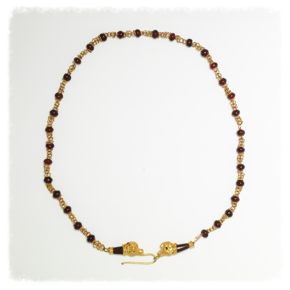 Made in 200-100 BC, this ancient Roman necklace consists of a gold chain strung with garnet beads. From the Victoria and Albert M