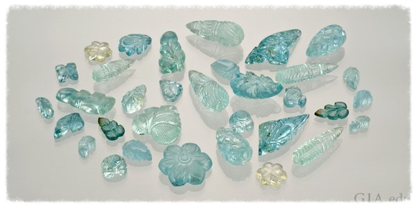 Carved aquamarine stones. Image from the Gemological Institute of America.