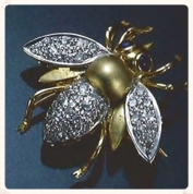 Green gold bee pin with pave diamond wings