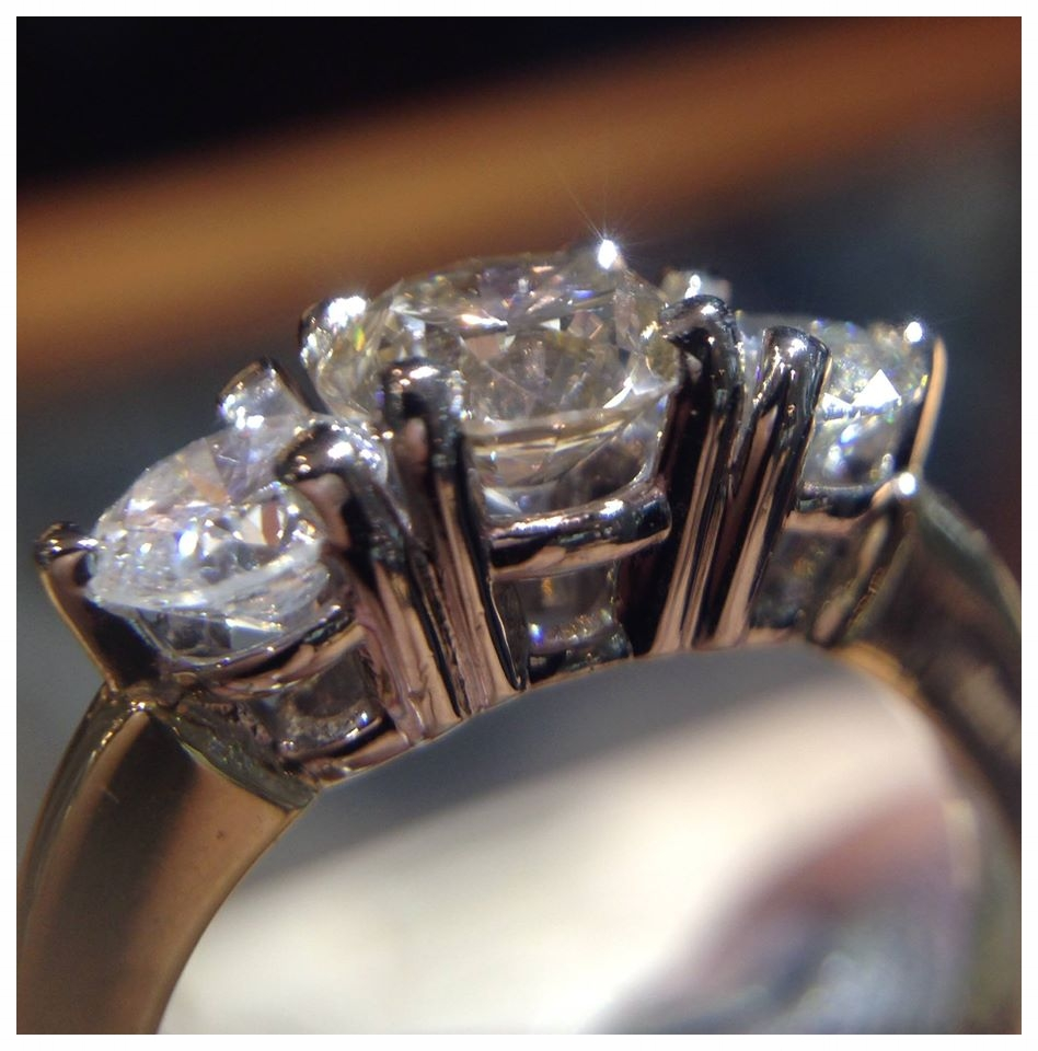 The prongs on this ring are all in their proper places. A prong that is bent might be just slightly lifted or pulled quite a distance away from its gemstone.