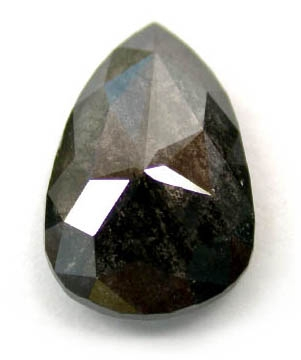 "Here is an image of an incredible untreated 1.11 carat rose-cut pear-shaped black diamond from Krikawa. Look closely and you will observe that the stone is not a transparent, ""glassy"" black but seems filled with something mysterious. That inner texture is a result of the inclusions."