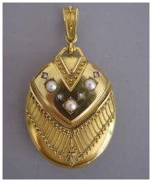 Etruscan revival locket