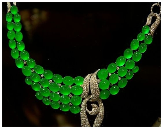 This amazing jade necklace appears to glow with a green inner light.  The cabochon cut is ideal for capturing this quality of jade.