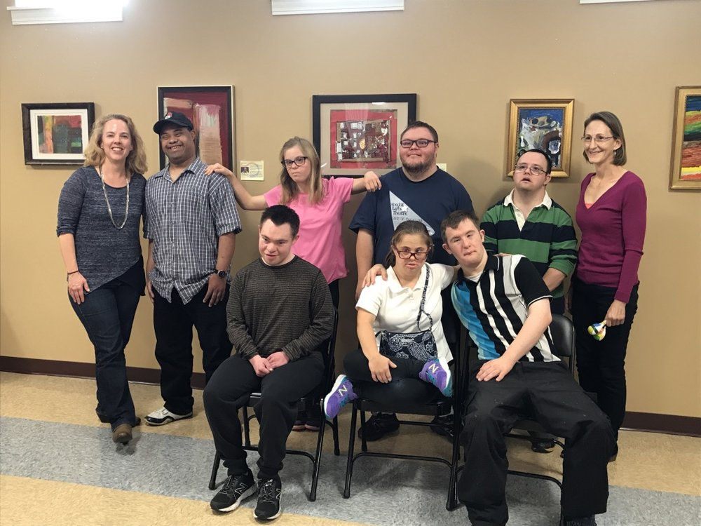 PRCOrchestra Principal Horn player Lisa Taylor and music therapist Nancy Swanson pose with students of the fall 2017 PRCOrchestra Adult Down Syndrome Music Class