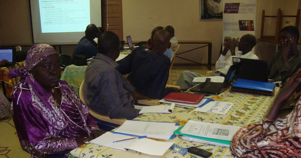 Fatou (left in purple) in her work group.
