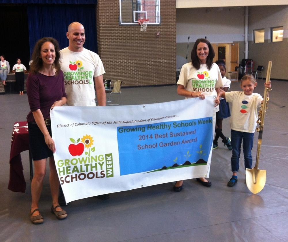 Tillie accepts the 2014 Best Sustained School Garden Award during Growing Healthy Schools Week.