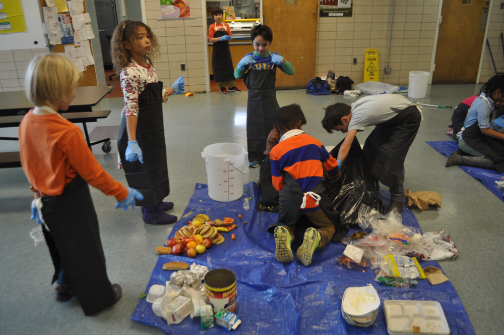 Our afternoon was spent with Brooke Hartman from the Sustainability and Energy Division of DGS who brought the supplies we needed to conduct a waste audit of our cafeteria.  It was a messy job, but students had aprons and gloves, and were very surprised by what they found.