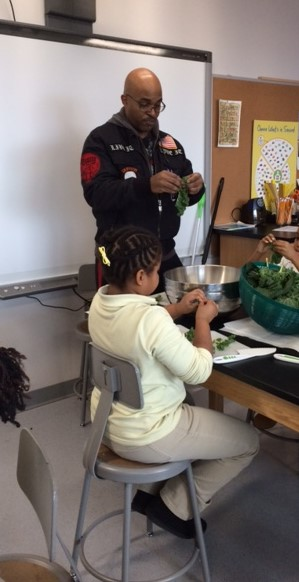 Mr. Young leads students in kale preparation.