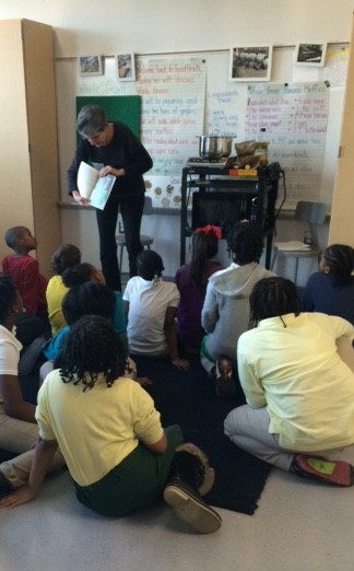 Ms. Helen reads a book to the class.