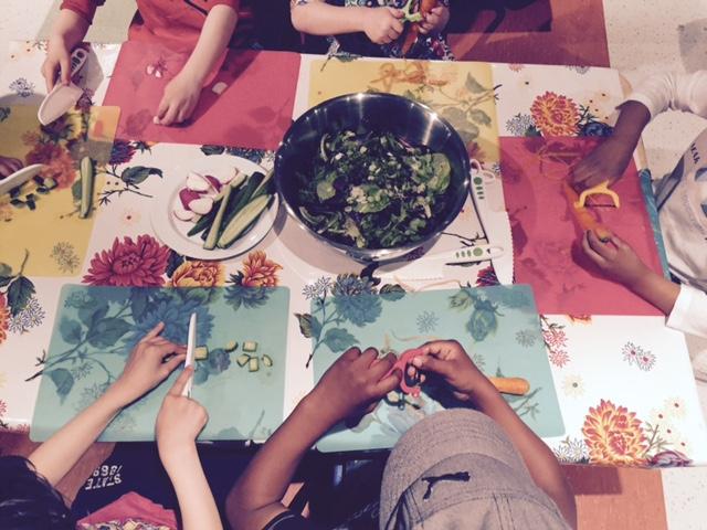 Little hands making a big salad.