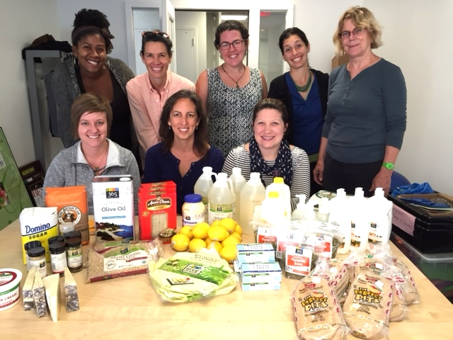 Members of the FoodPrints Team pose with groceries from sponsor Whole Foods Market