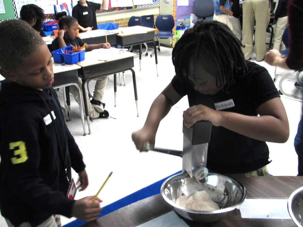 Students grind their own FLOUR from local wheat berries purchased at the Dupont Circle FRESHFARM Market. Now that's cool.