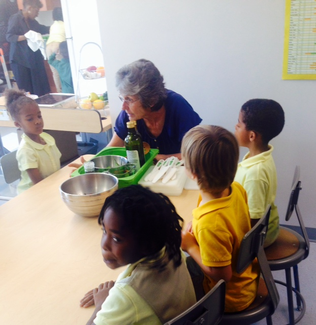 Ms. Helen leads a cooking activity in FoodPrints at Ludlow-Taylor.