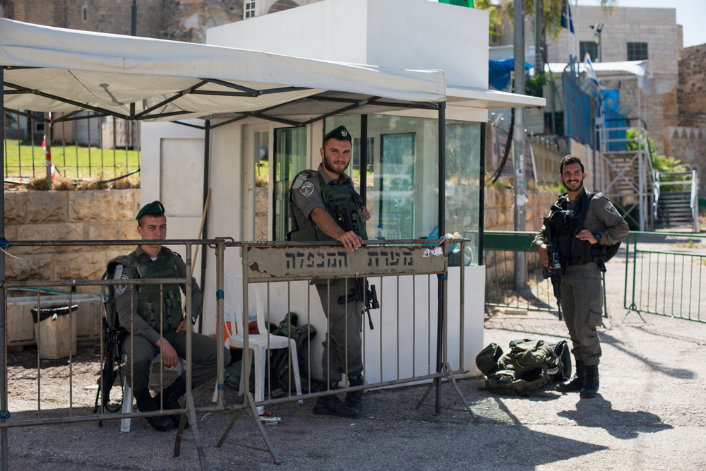 Israeli military officers guard and survey a corner in the Old City.
